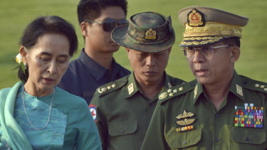 Aung San Suu Kyi has lost a power struggle with Senior General Min Aung Hlaing, right.