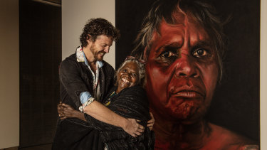 Artist David Darcy with Daisy Tjuparntarri Ward in front of his Archibald Prize People's Choice award-winning portrait.