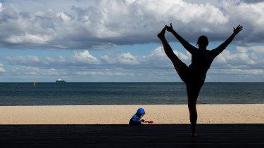 A woman exercises near St Kilda beach on Tuesday.