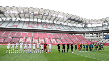 Australia  and the US women's soccer teams sing their national anthems before an empty stadium..