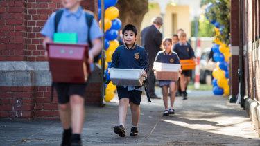 Students at St Brendan's Primary School in Flemington return to school on Monday.