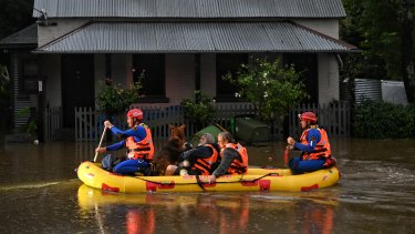 SES teams rescue Windsor residents from their homes during the floods earlier this year.