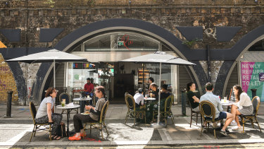 """People dine outdoor at a cafe in Brixton on August 2. British Prime Minister Boris Johnson has said it is time to """"squeeze that brake pedal"""" on reopening the economy, amid rising fears the UK is on the brink of a second wave."""