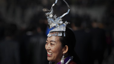 A minority delegate arrives at the Great Hall of the People,