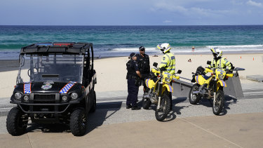Police at Surfers Paradise Beach on the Gold Coast, Thursday, April 2, 2020.
