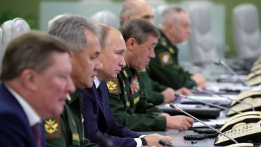 Vladimir Putin surrounded by military and civilian chiefs oversees the test launch of the Avangard hypersonic glide vehicle.