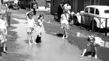Children play in the puddles at Bradfield Park in 1958.
