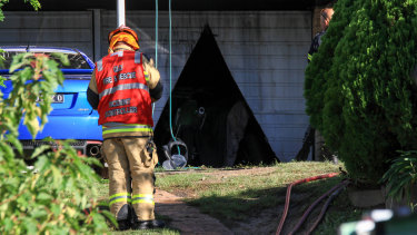 Firefighters had to cut their way into the garage.