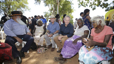 Senator Pat Dodson, left, with Opposition Leader Bill Shorten and community members on Bathurst Island.