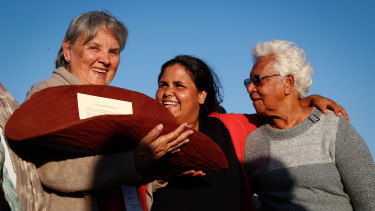 Pat Anderson, Sally Scales and Irene Davey are pictured in May 2017 holding a piti with the Uluru Statement from the Heart.
