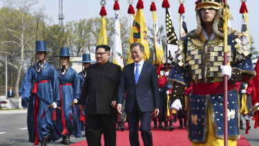 North Korean leader Kim Jong-un, left, and South Korean President Moon Jae-in walk together at the border village of Panmunjom in the Demilitarised Zone