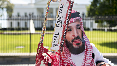 A demonstrator wears a mask of Mohammed bin Salman, Saudi Arabia's crown prince, during a protest outside the White House in Washington on Friday.