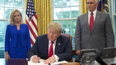 President Donald Trump signs an executive order to keep families together at the border.