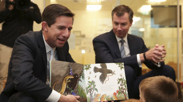 Education Minister Simon Birmingham reads to children at a childcare centre in Canberra.