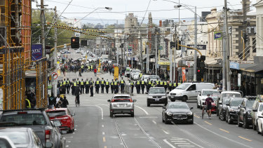 Police are seen approaching protesters in Bridge Road, Richmond.