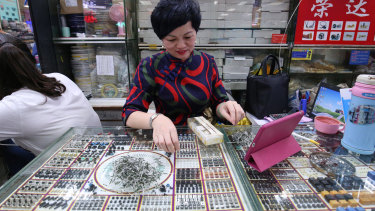 A shop owner at the electronics and comupter market in Shenzhen's Huaqiangbei.