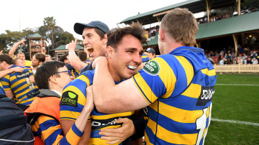 Local heroes: Sydney University players celebrate winning the Shute Shield grand final at North Sydney last year.