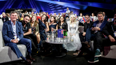 Kate Miller-Heidke seated with the Australian Eurovision delegation backstage at the Eurovision Song Contest.