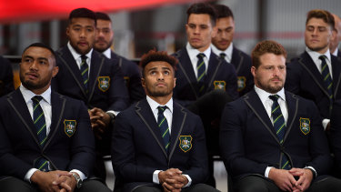 Senior figure: Sekope Kepu, left, with Will Genia and James Slipper in the front row of the Wallabies squad during the World Cup announcement.