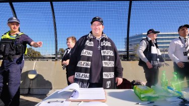 Collingwood member David Hatley taking signatures in order to spill the Magpies board.
