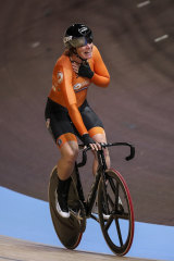 The Netherlands' Kirstin Wild celebrates her gold medal in the women's scratch race at the world track cycling championships.