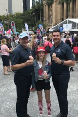 Prince Charles Hospital Foundation CEO Michael Hornby and journalist Bill McDonald with Madeleine, the daughter of strawberry growers.