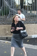 Rebecca Cartwright leaves Parliament House after collecting a hard drive for ICAC.