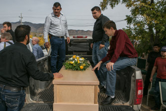 Devin Langford, 13, right, sits by the coffin of his brother, Trevor, who was 11.