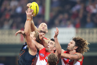 Sam Reid (back) is ready to spend more time in the ruck if required after Tom Hickey's injury.