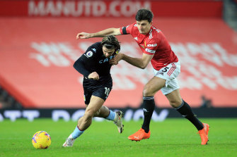 Aston Villa's Jack Grealish (left) battles for possession with United's Harry Maguire.