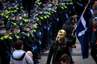 A police line forms at a lockdown protest in Melbourne's CBD.
