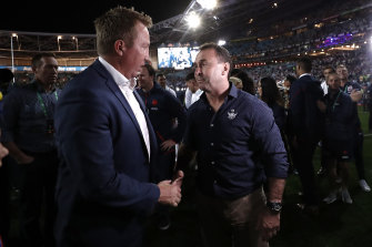 Roosters coach Trent Robinson and Raiders coach Ricky Stuart chat after last year's grand final.