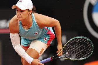 Barty at first tried to continue the match with a compression sleeve on her arm, before retiring injured.