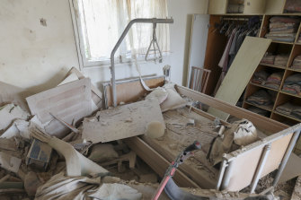 A house is heavily damaged after it was hit by a missile fired from the Gaza Strip.