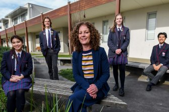 Casey Grammar principal Fiona Williams with year 12 students. Casey Grammar was named the Schools that Excel winner among non-government schools in Melbourne's south.