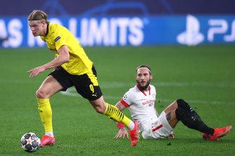 Erling Haaland gets away from Sevilla's Nemanja Gudelj during Borussia Dortmund's Champions League win over the Spaniards.