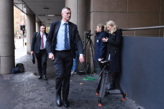 AFP officers arrive at the ABC on June 5.