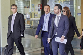 Party boat operator Joe Elias, centre, leaves court on Thursday, where he is facing eight charges.