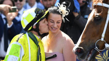 Takeover bid: Eduardo trainer Sarah Zschoke gets a kiss from jockey and partner Brian Park.