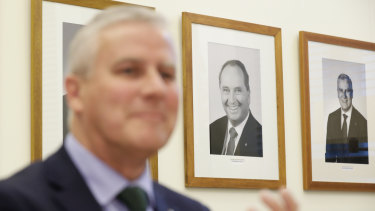 A portrait of former Nationals leader Barnaby Joyce hangs on the wall behind Deputy Prime Minister Michael McCormack.