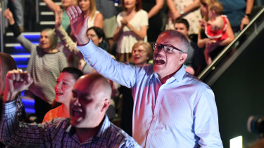 Scott Morrison sings during an Easter Sunday service at his Sydney church.