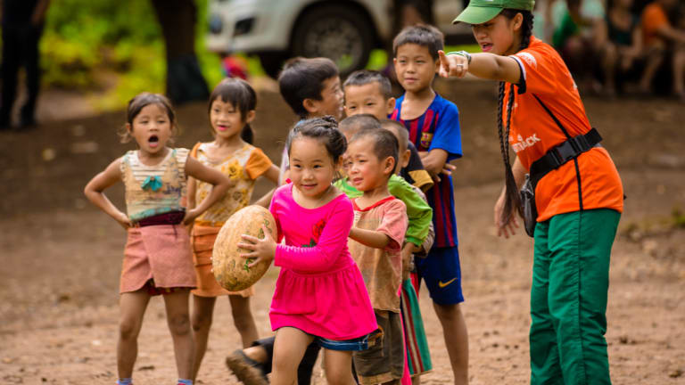Whole new ball game: Children  learns the basics of rugby in Laos.
