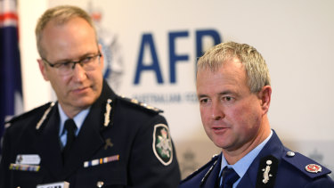 AFP Assistant Commissioner Ian McCartney and NSW Police Assistant Commissioner Michael Willing address media in Sydney on Tuesday.