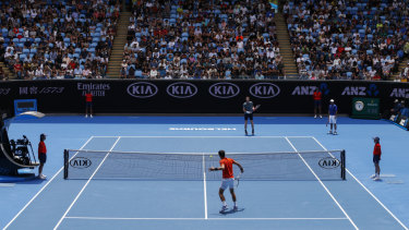 Andy Murray and Novak Djokovic play a practice match at Melbourne Park.