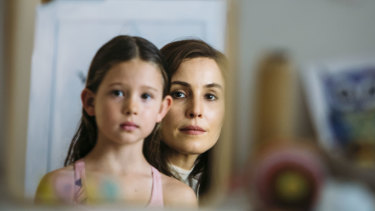 Annika Whiteley as Lola and Noomi Rapace as Lizzie.