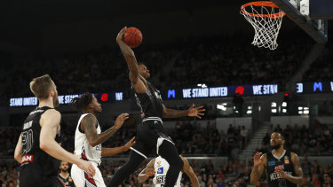 Winding up: United's Casey Prather flies high for a dunk attempt.