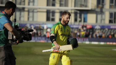 Australia's David Warner leaves the field after the Cricket World Cup match against Afghanistan.