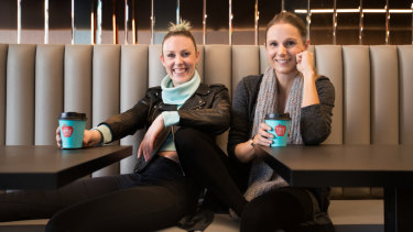 Lauren Davie (left) and Elena Andoniou haven't noticed an impact from the company tax cut.