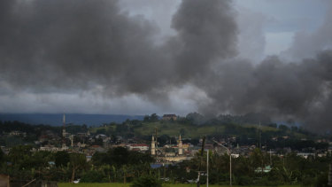 Black smoke rises above a mosque in Marawi city, southern Philippines as it tried to wipe out militants linked to the Islamic State group last year.