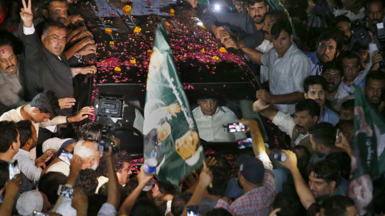 Supporters showered former Pakistani prime minister Nawaz Sharif's car with rose petals after his release from prison.